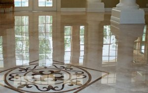 Luxury marble floor tiling with intricate fleur-de-lis pattern