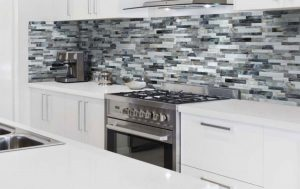 Brick Mosaic effect applied to backsplash walls above stove in kitchen