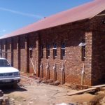 A side view image of face bricking a building